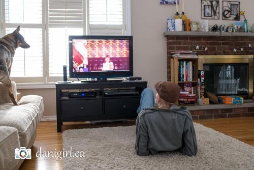 Papa Lou watching the anniversary photo slideshow