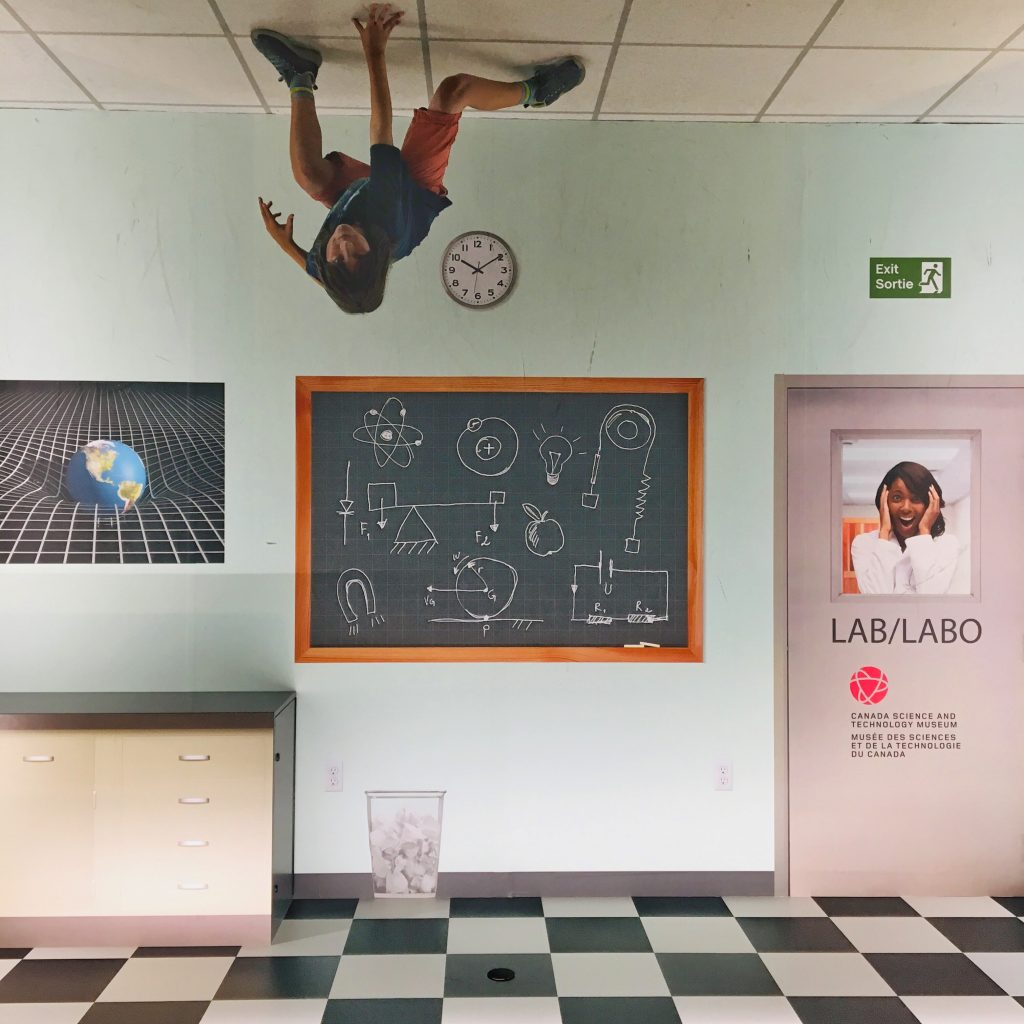 Photo of a child upside down in a classroom