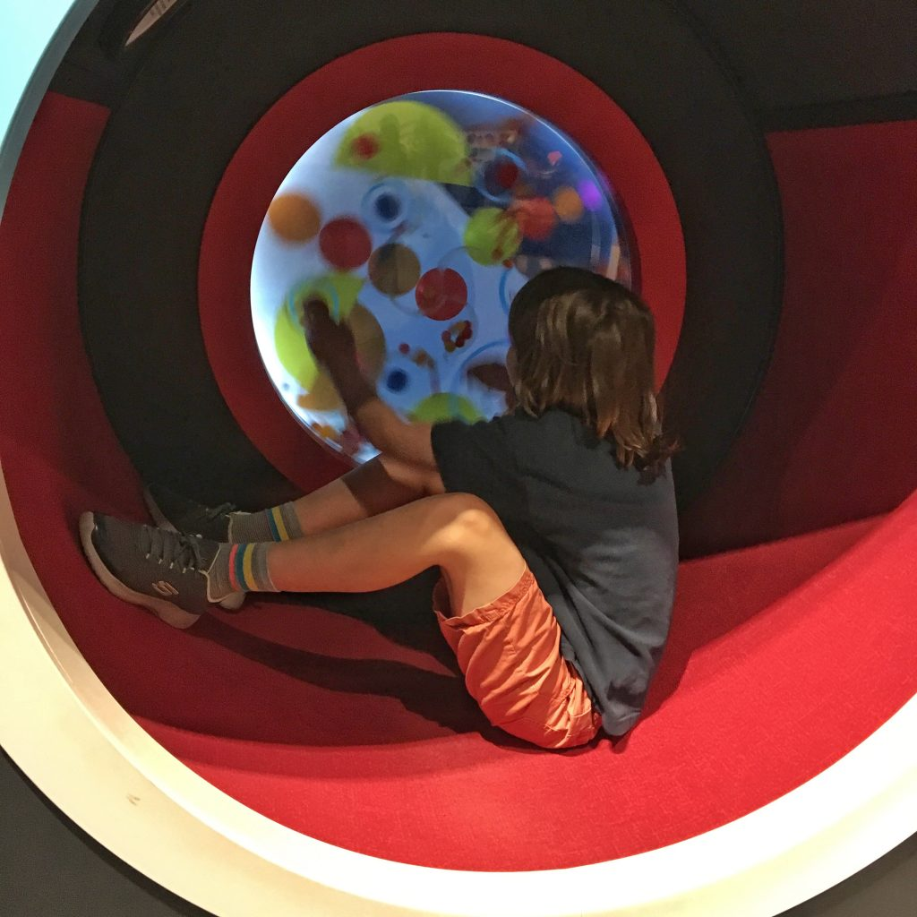 Child playing with gears at Canada Science and Technology Museum