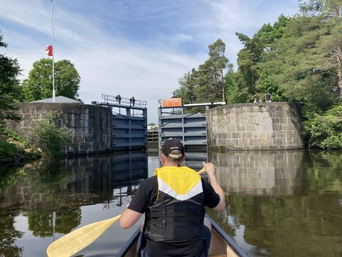 approaching an opening rideau canal lock from the perspective of a canoe
